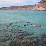 Snorkeling in a tranquil bay.