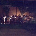 Group Dinner Garden Setting at Night