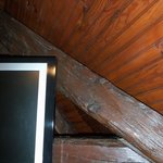 Flatscreen mounted on wooden beams