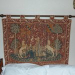 A real antique tapestry hung over the bed