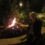 Cooking our s'mores over open fire outside hotel
