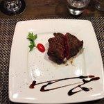 The steak, rare, peferctly made.