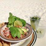 Delicious fresh mixed ceviche and drinks delivered to me on the beach