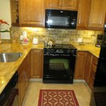 Kitchen - newly renovated with granite countertops - unit 111