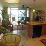 Living room & sliding door to Lanai/Patio - wonderful ocean view - unit 111
