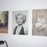 Marilyn Munroe pictures on bedroom wall