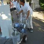 Painters spray painting.  We'll be back at 7am.