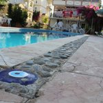 outdoor pool and a sun terrace equipped with sun loungers and parasols