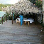 Massage tables on the deck overlooking the ocean