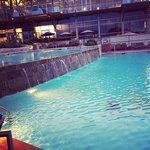 Adult pool with swim-up bar
