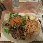 French cut steak with fries and salad