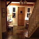 Le chaleureux hall d'entrée de la maison