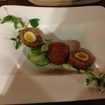 Quail eggs with duck confit