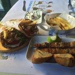 The Gyro Pitas with chicken, pork skewers, fresh-cut potatos and home made tzaziki