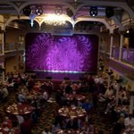 View of stage, dinner seating, and balcony.