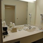 The sink and mirror in the hall of the room