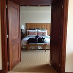 Double doors open to the bedroom