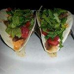 Steak Tacos w / arugula & roasted red pepper cheese