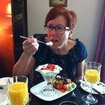My wife enjoying 'Elaine's fruit sundae', for breakfast.