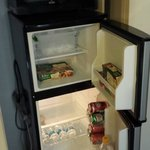 Plenty of room in the mini fridge for a bottle of wine or 3