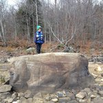 My little-big guy on top of a boulder on a nearby point during one of our kayaking excursions at