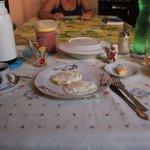 breakfast consist in eggs, fresh fruits, bread, butter, coffee/tea and juice
