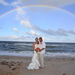 perfect rainbow as a backdrop to our gorgeous beach wedding