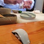 Chef preparing ika nigiri right on the spot