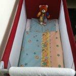Baby's crib. Teddy bear included