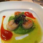 Pan fried Norwegian scallops on peas puree pillow with truffle oil and Chorizo
