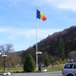 Romanian flag in front of monastery entrance
