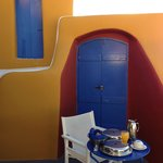 Breakfast in the Villa by the iconic blue door + orange walls