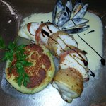 Prime Fillet of Monkfish wrapped in Parma Ham served on a Spring Onion Potato Cake with a Mussel