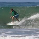 Surfing on one of Al Chile's boards at Playa Santa Teresa