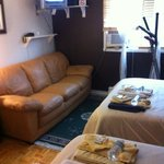 Bedroom #1, w/ 2 beds, leather sofa, exercise machin, flat screen TV