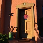 The welcoming door at Sunset House in the morning light.