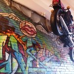 wall art and a hanging motorcycle