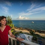 Sally Herschorn looks over the balcony at the penthouse level of Cobalt Coast Resort