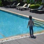 Baby girl checking the pool