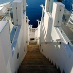 Stairs going down to other suites and the path to Fira