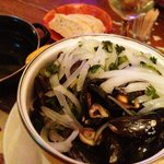 Mussels steamed with white wine, onions and parsley.