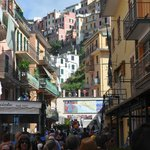 The main street of Manarola - busy in late September.