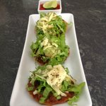 Bar Luna tostaditas with refried beans and guacamole