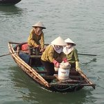 lady rowers transport people from the fish hatcheries to shore