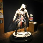 A life size statue of Connor from Assassins Creed III outside of the history of video game exhib
