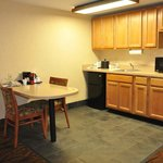 Nice kitchen area with refrigerator and microwave