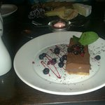 Dessert. Dark chocolate cheesecake and also you can just see cheese board!