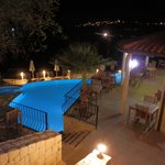 Pool and terrace dining area at night