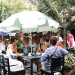 Guest enjoying their afternoon time with their loved ones accompanied by by delicious food and p