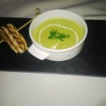 Serrano ham and pea soup with manchego cheese toast